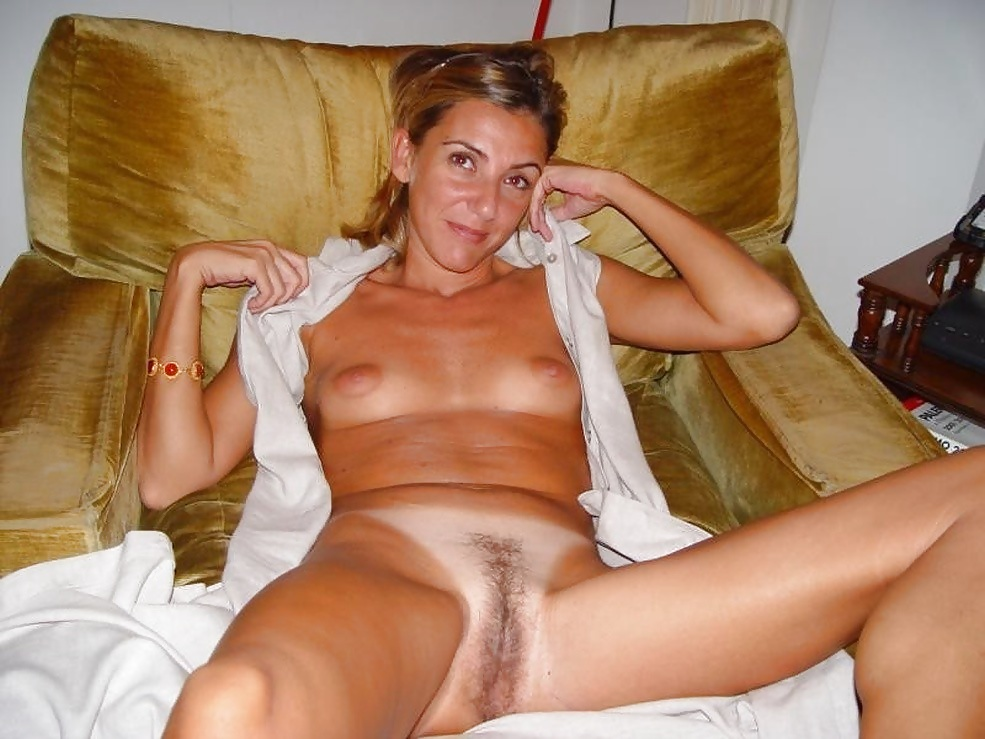 Naked mature women sitting on toilet